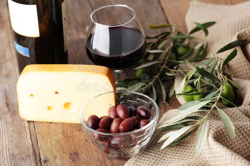 Cheese, olives, and wine royalty free stock photo