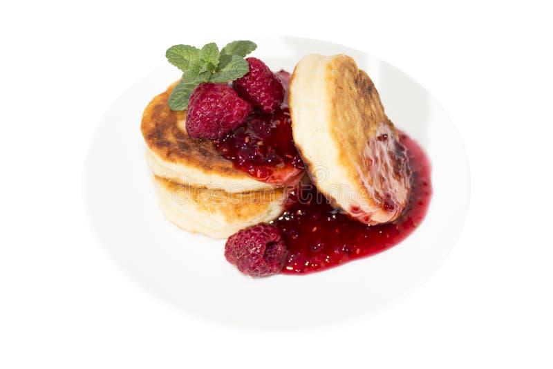 Cheese pancake with raspberries jam stock images