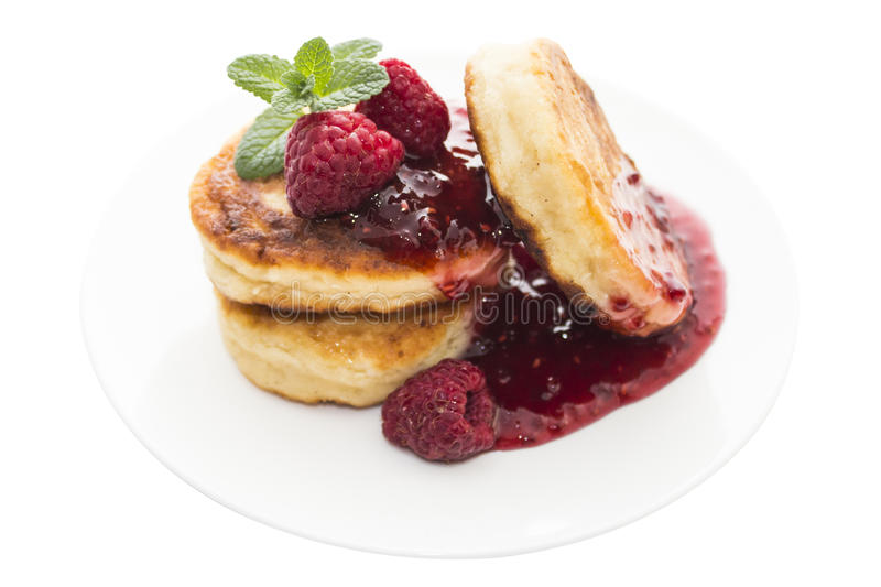 Cheese pancake with raspberries and mint stock photos