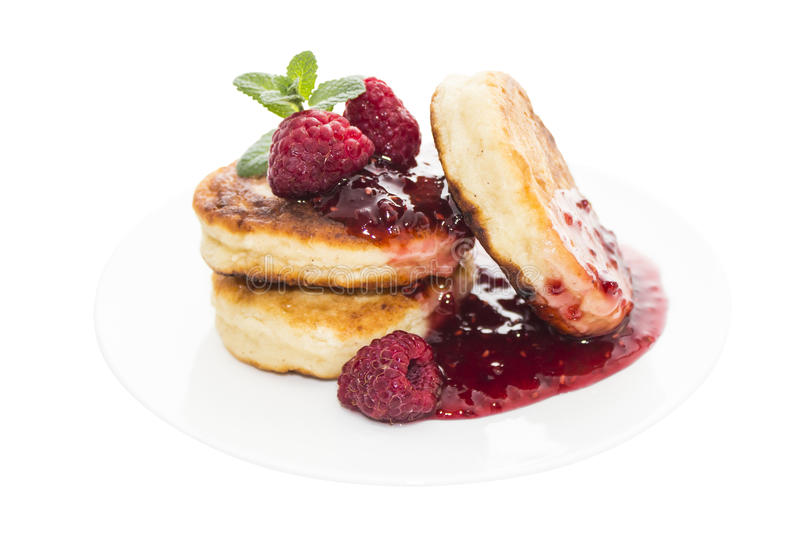 Cheese pancake with raspberries on plate stock photos