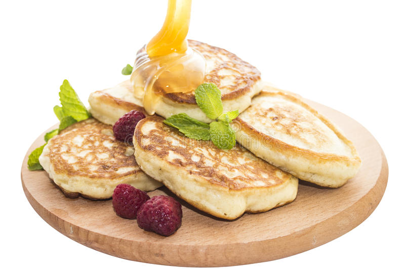 Cheese pancakes with honey royalty free stock photography