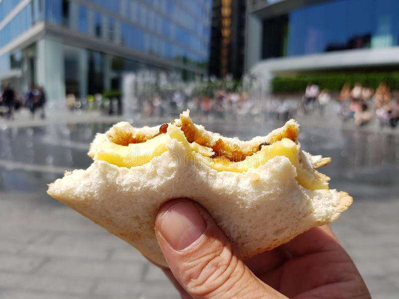 A cheese and pickle sandwich being consumed in London, England royalty free stock photos