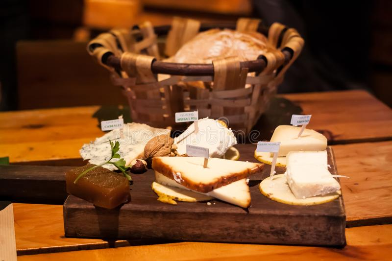 Cheese plate of Asturian cheese: Cabrales, Afuega'l Pitu, Vidiago, Queso de Oveja sheep milk cheese and Ahumados smoked cheese stock images