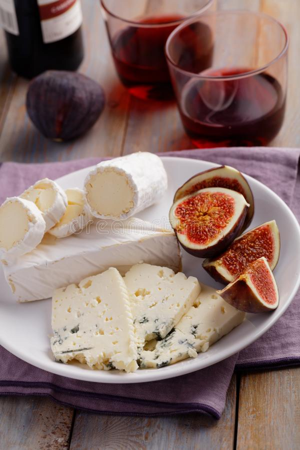 Cheeses and figs stock image