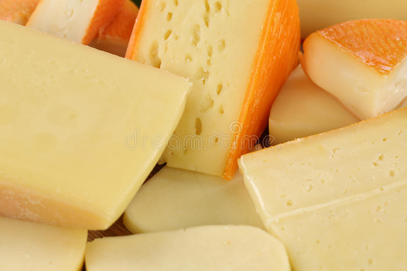Cheese plate with Gouda, hard and Swiss cheese royalty free stock photo