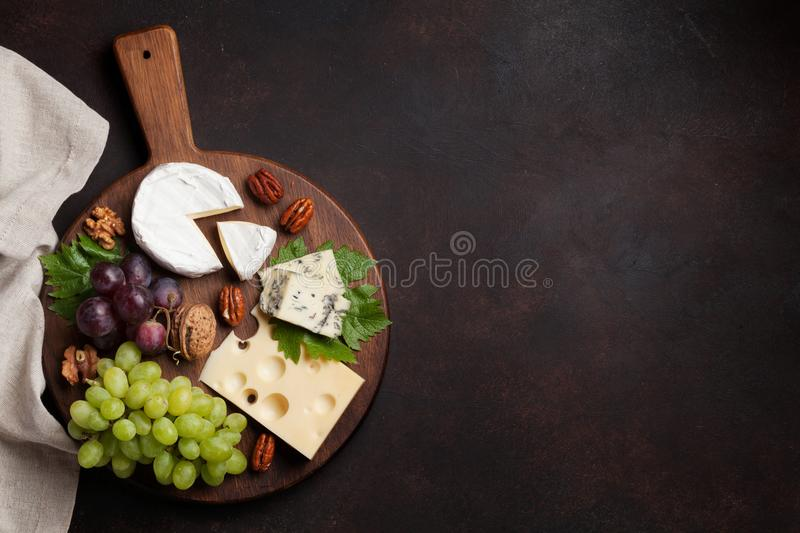 Cheese plate with grapes and nuts stock photos