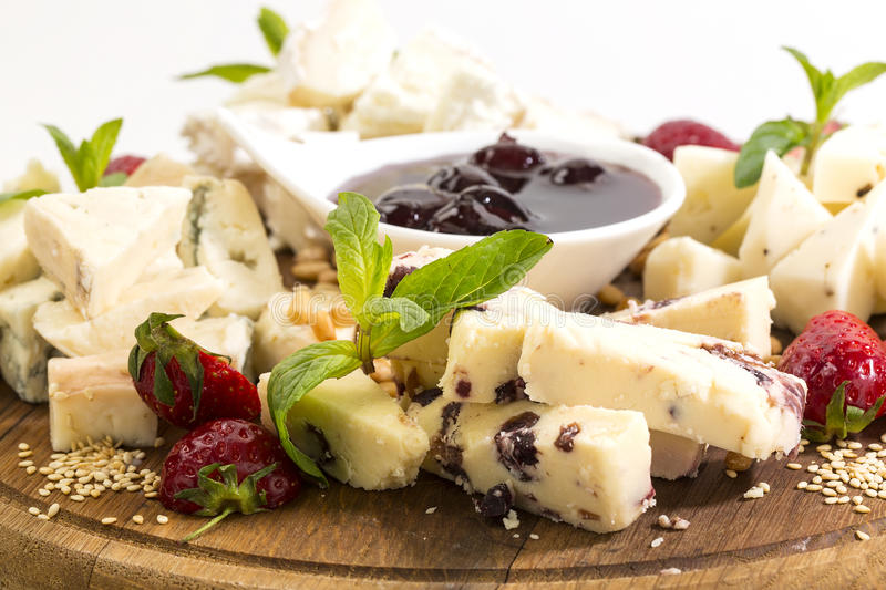 Cheese plate. With a large decorated the assortment of mint royalty free stock photo