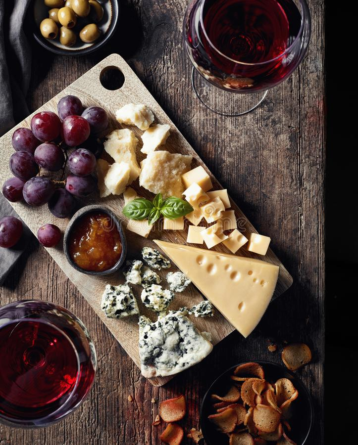 Cheese plate and red wine stock image