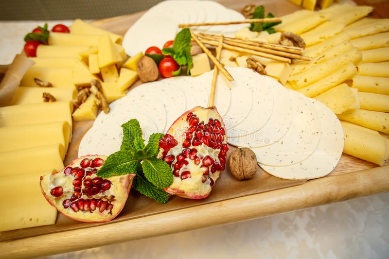 Cheese plate with variety of appetizers on table royalty free stock photography