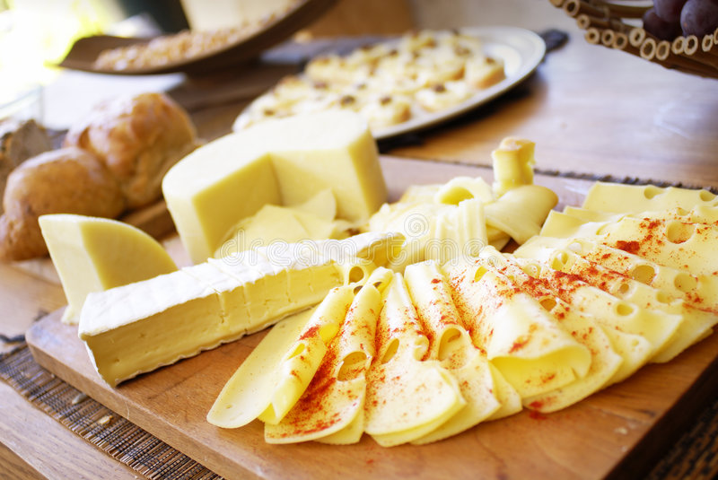 Cheese platter. Many cheese types with breadstuff stock image