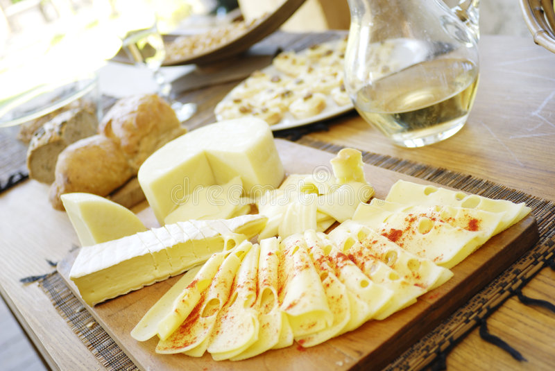 Cheese platter. Many cheese types with breadstuff stock photography