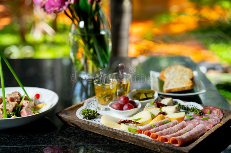 Cheese platter with lotus flower background royalty free stock photos