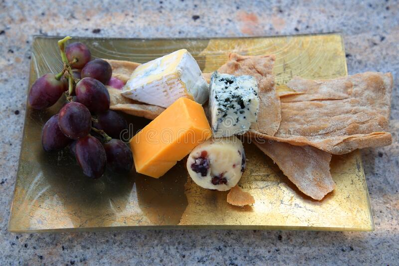 Cheese platter served with grapes stock images