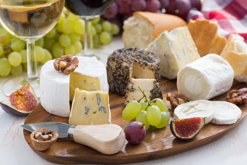 Cheese platter, snacks and wine stock photos