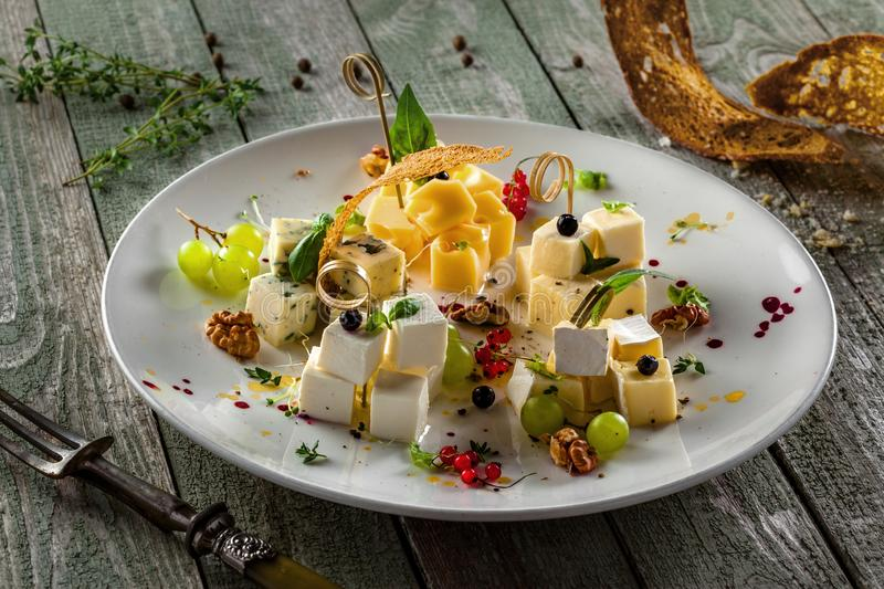 Cheese platter on a table stock photo