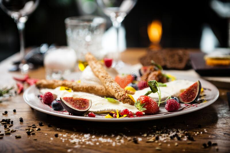 Cheese platter for two served on a plate in restaurant stock image