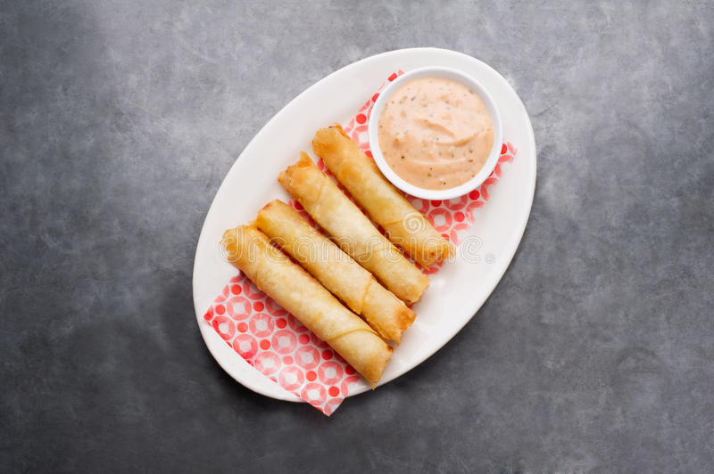 Cheese rolls plate with cocktail sauce served in a wooden plate on a rustic ba stock photos