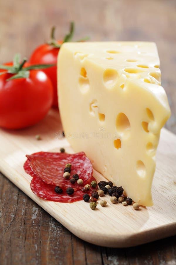 Cheese and salami royalty free stock photos