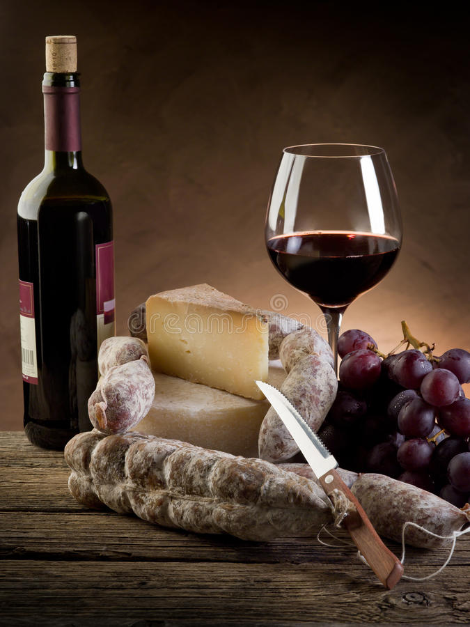 Cheese salami grapes and wine. Cheese salami grapes and red wine stock photography