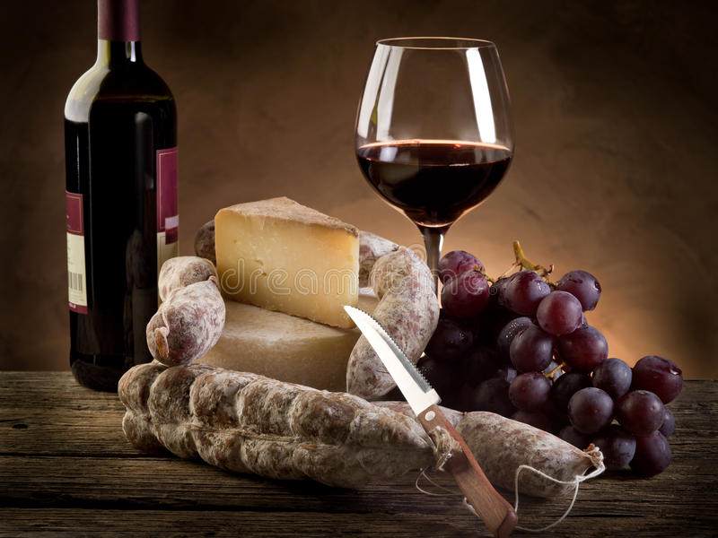 Cheese salami grapes and wine stock photo