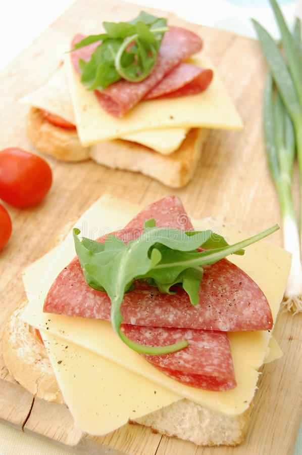 Cheese and salami on toast royalty free stock photography