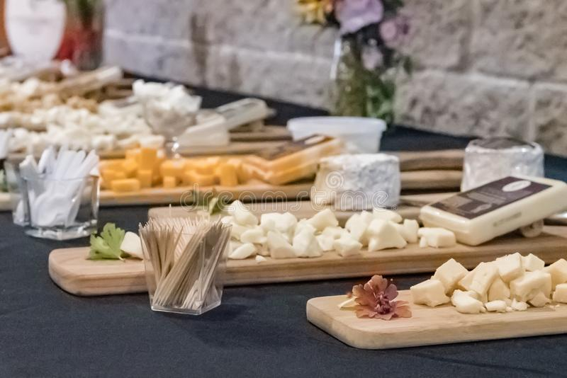 Cheese samples. Laid out on display boards at a local creamery in Wisconsin stock photos