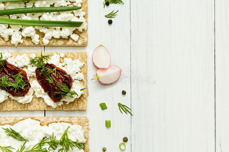 Cheese sandwiches with vegetables on a white background. Space for text royalty free stock photos