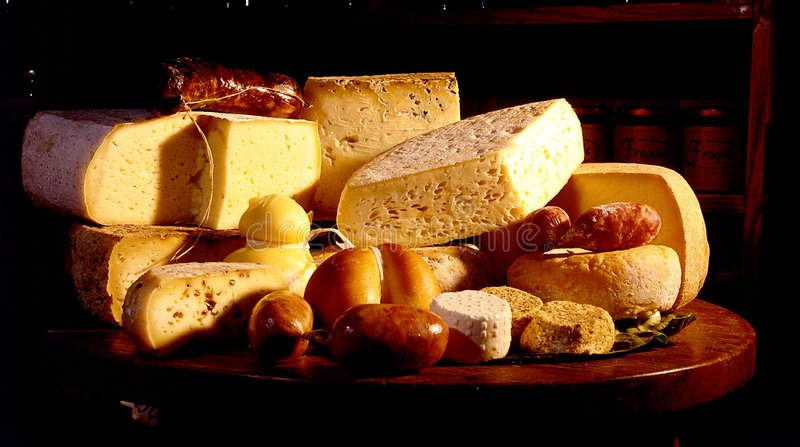 Cheese and sausages stock photos