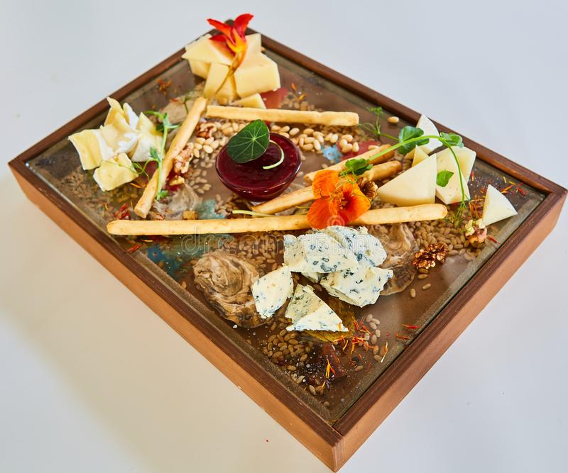 Cheese selection on wooden rustic board. Cheese platter with different cheeses on wood. royalty free stock photo