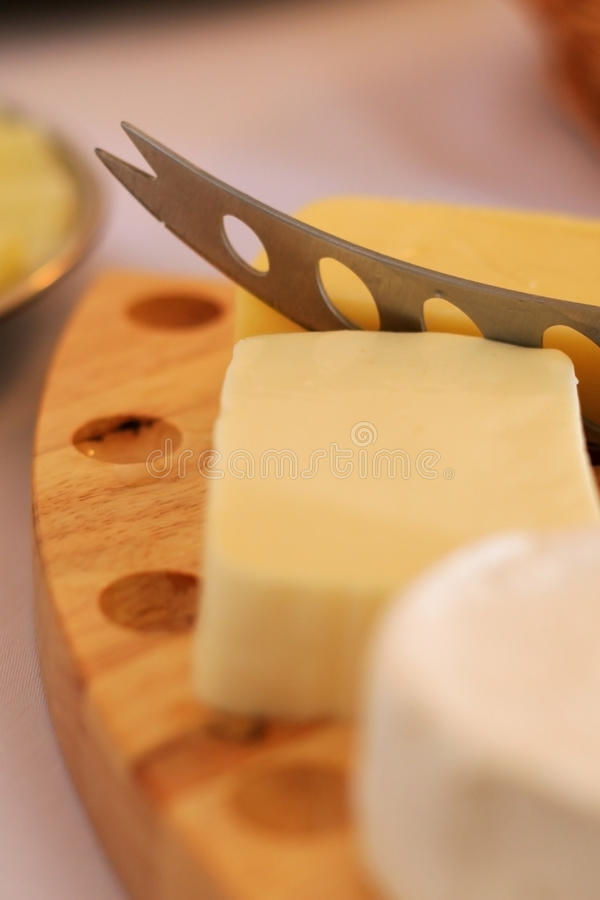 Download Cheese slicing stock photo. Image of knife, wooden, buffet - 10338040