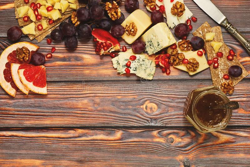 Cheese snack on unfinished wooden background royalty free stock photos