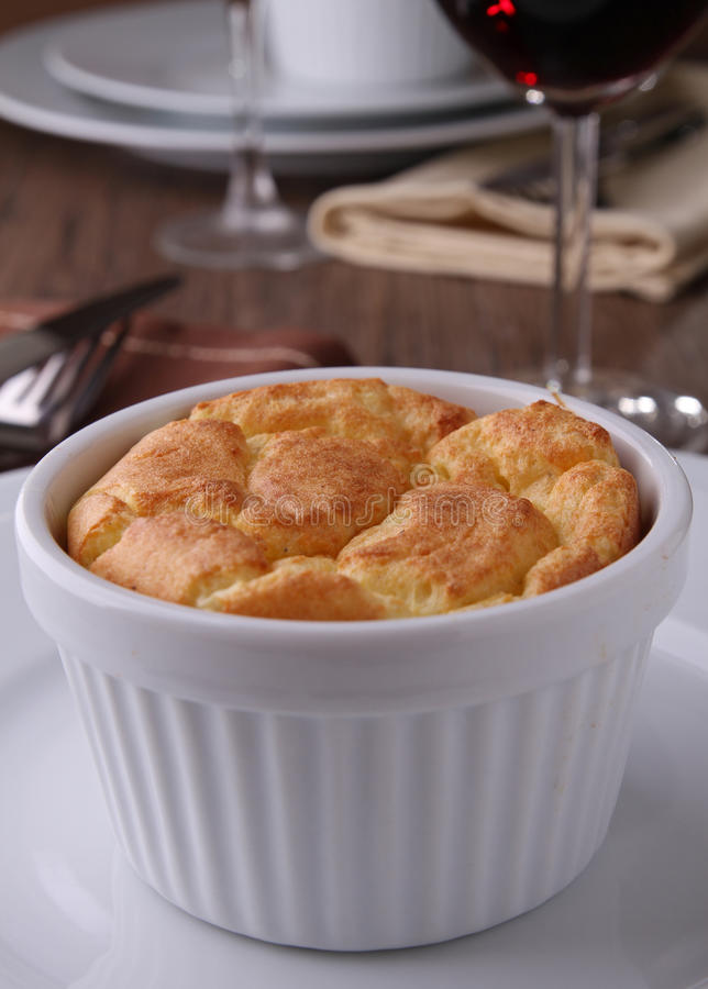Cheese souffle. Ramekin with cheese and potato souffle stock images