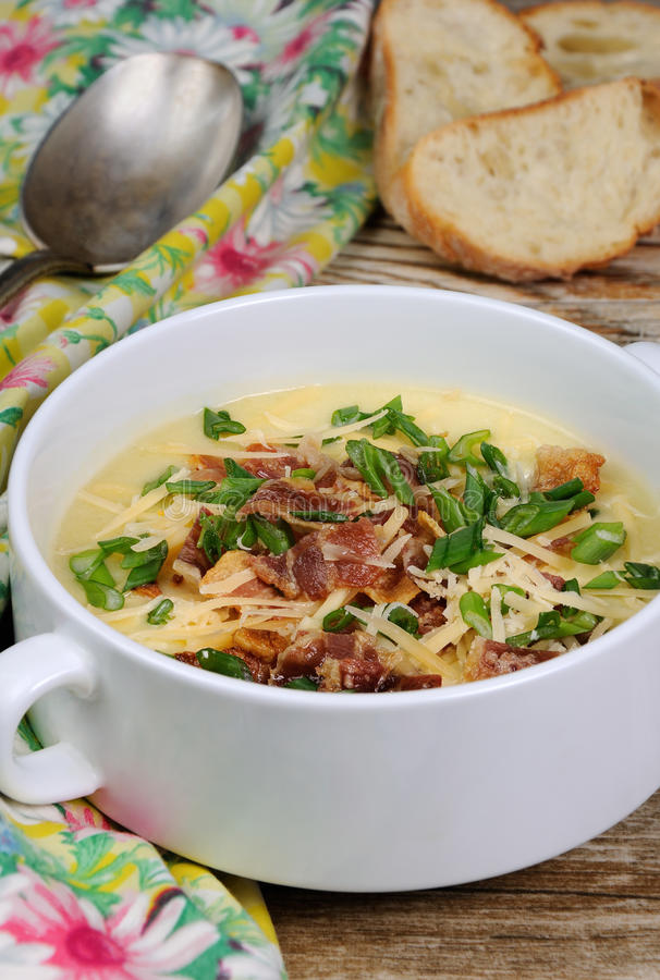 Cheese soup with bacon. Creamy Loaded Baked Potato Soup with Bacon and Cheese,green onions royalty free stock photo
