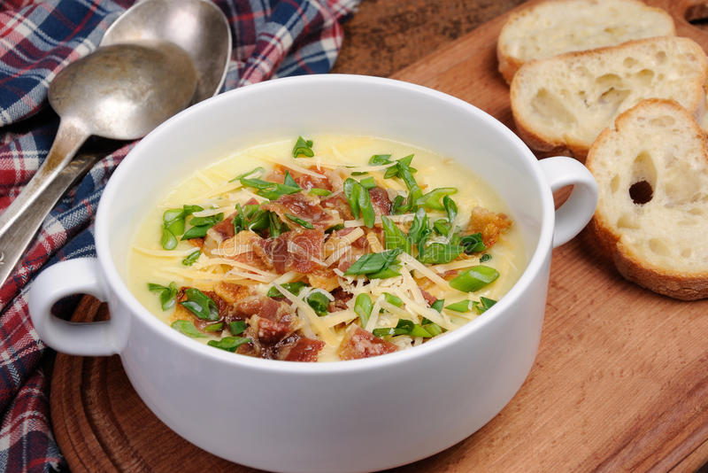 Cheese soup with bacon. Creamy Loaded Baked Potato Soup with Bacon and Cheese,green onions royalty free stock images