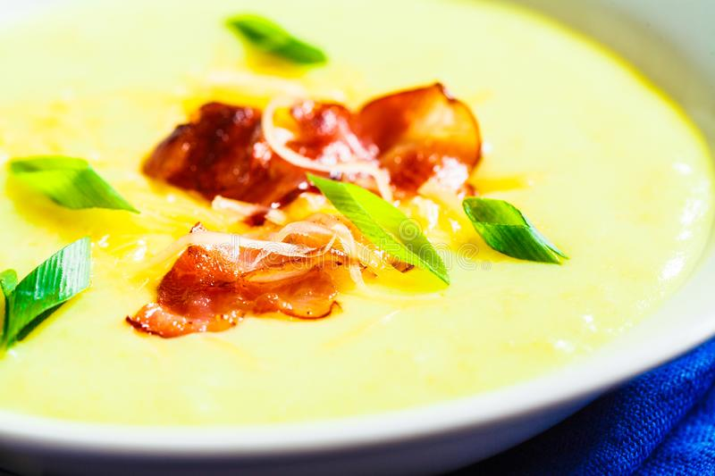 Cheese soup with bacon and green onions in white plate. Cheese soup with bacon and green onions in a white plate stock photos