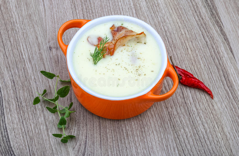 Cheese soup. With bacon and herbs on the wood background stock images
