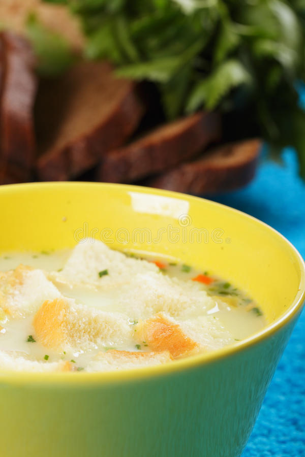 Cheese soup and bread royalty free stock images