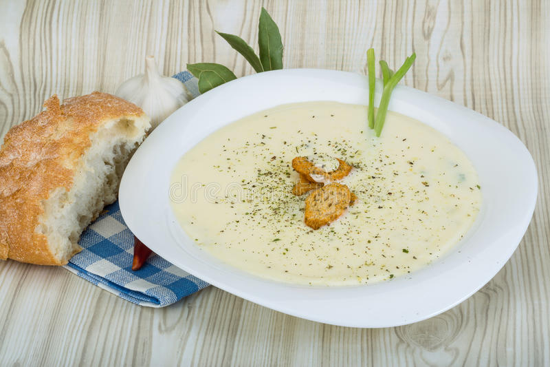 Cheese soup with croutons. Herbs and spices royalty free stock photography