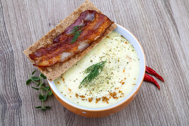 Cheese soup. With dill, bacon, spices and herbs royalty free stock photos