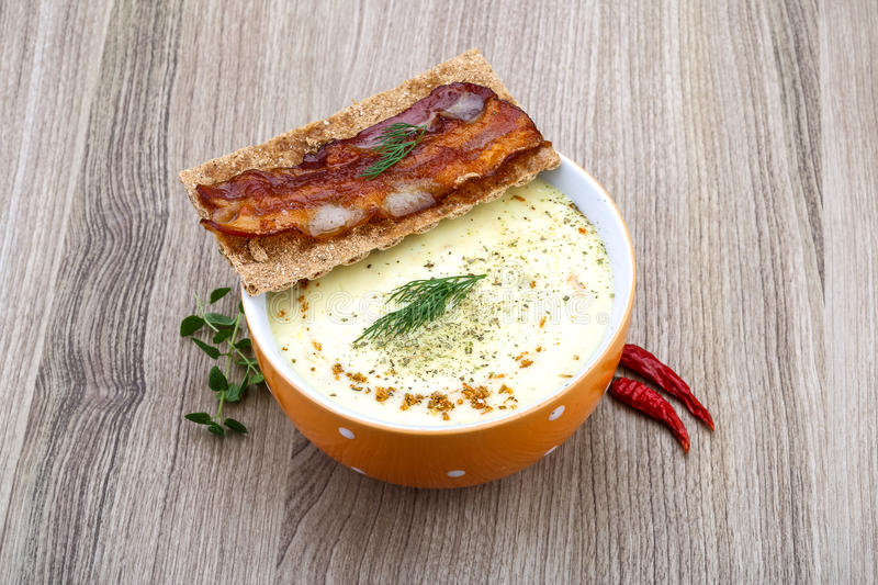 Cheese soup. With dill, bacon, spices and herbs stock photography
