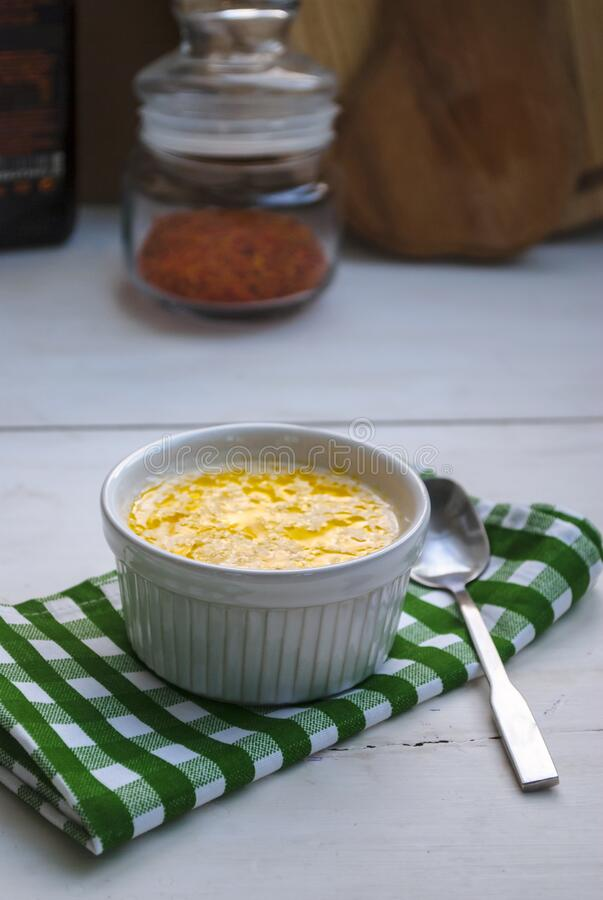 Cheese soup in a white dish on the table royalty free stock photography