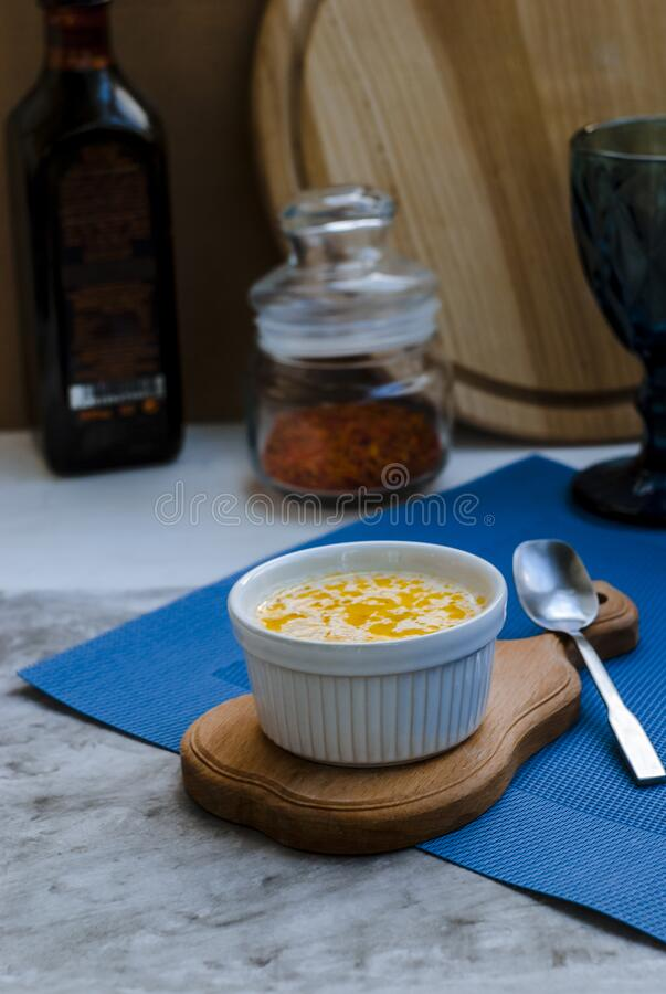 Cheese soup in a white dish on the table stock photos