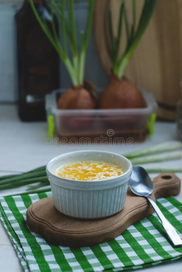 Cheese soup in a white dish on the table royalty free stock images