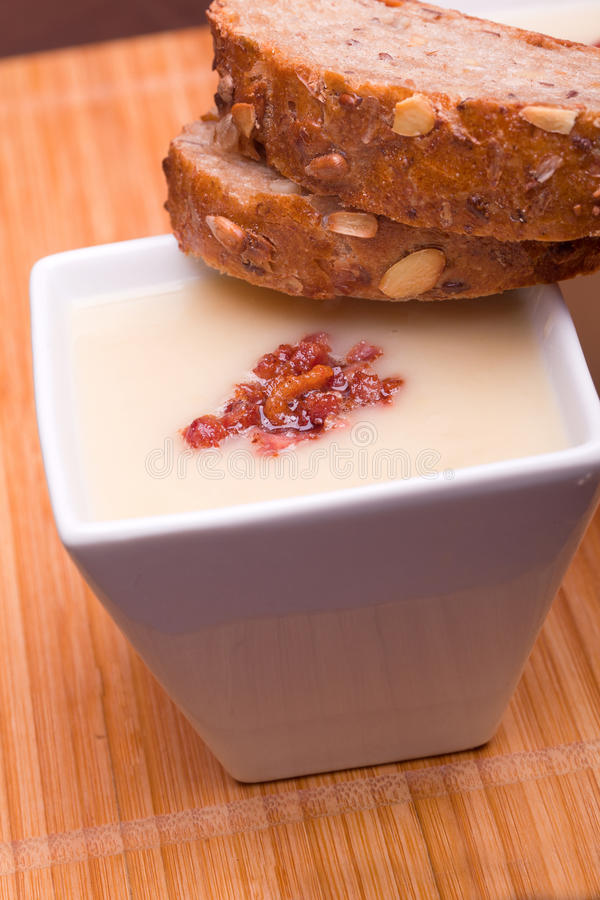 Cheese soup whith bacon and bread. Cream cheese soup whith bacon and bread stock images