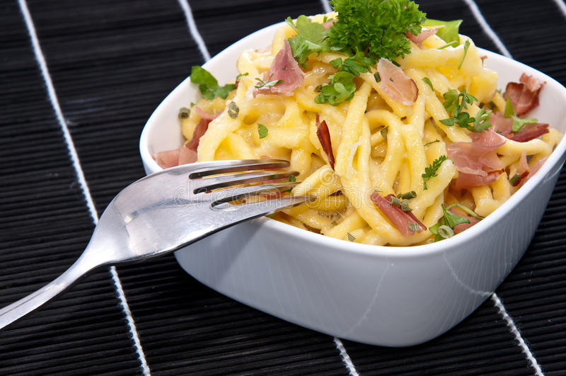 Cheese Spaetzle In A Bowl (on Black) Royalty Free Stock Image