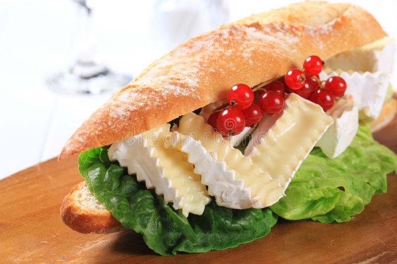 Cheese sub sandwich. Sub sandwich with white rind cheese and lettuce stock photo