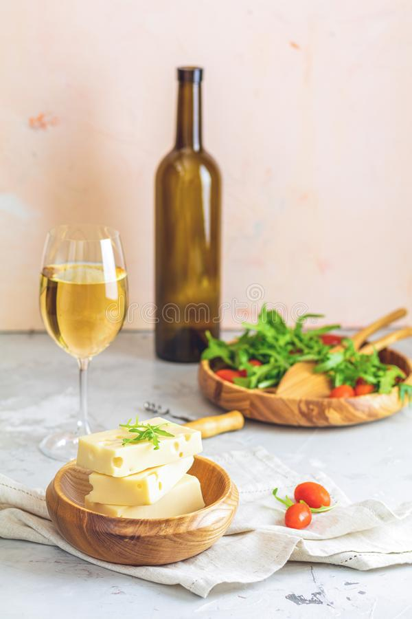 Cheese, tomatoes and arugula on the wooden plates royalty free stock images