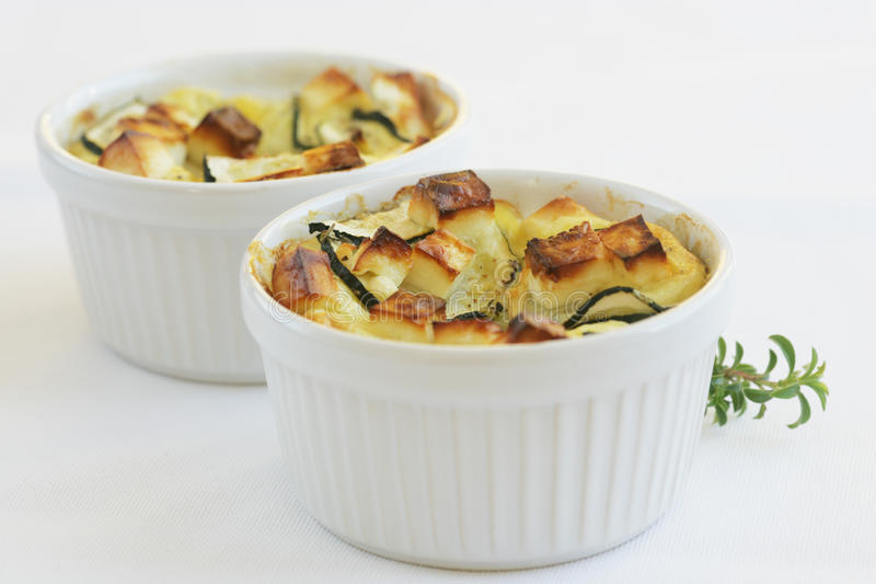 Cheese-topped dish of zucchini and feta