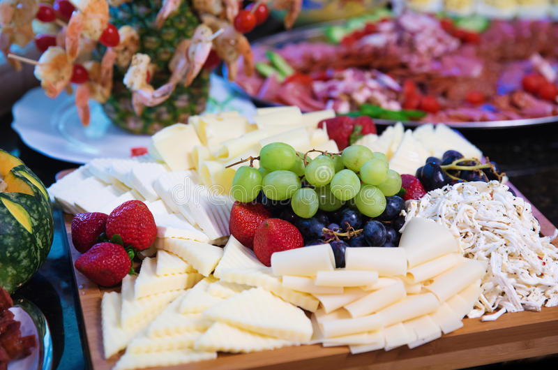 Cheese tray. Closeup of a cheese tray with fruits royalty free stock photos