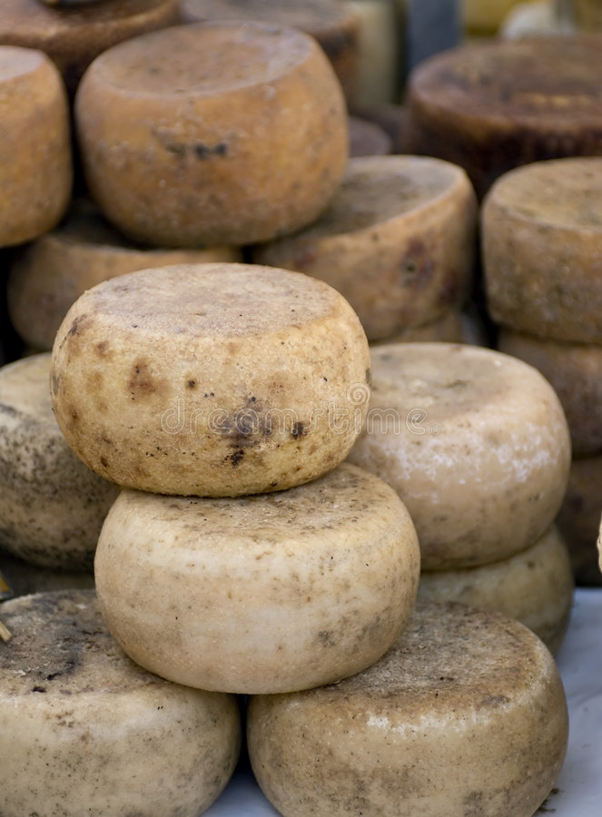 Cheese wheels. For sale in an open market in Italy royalty free stock images